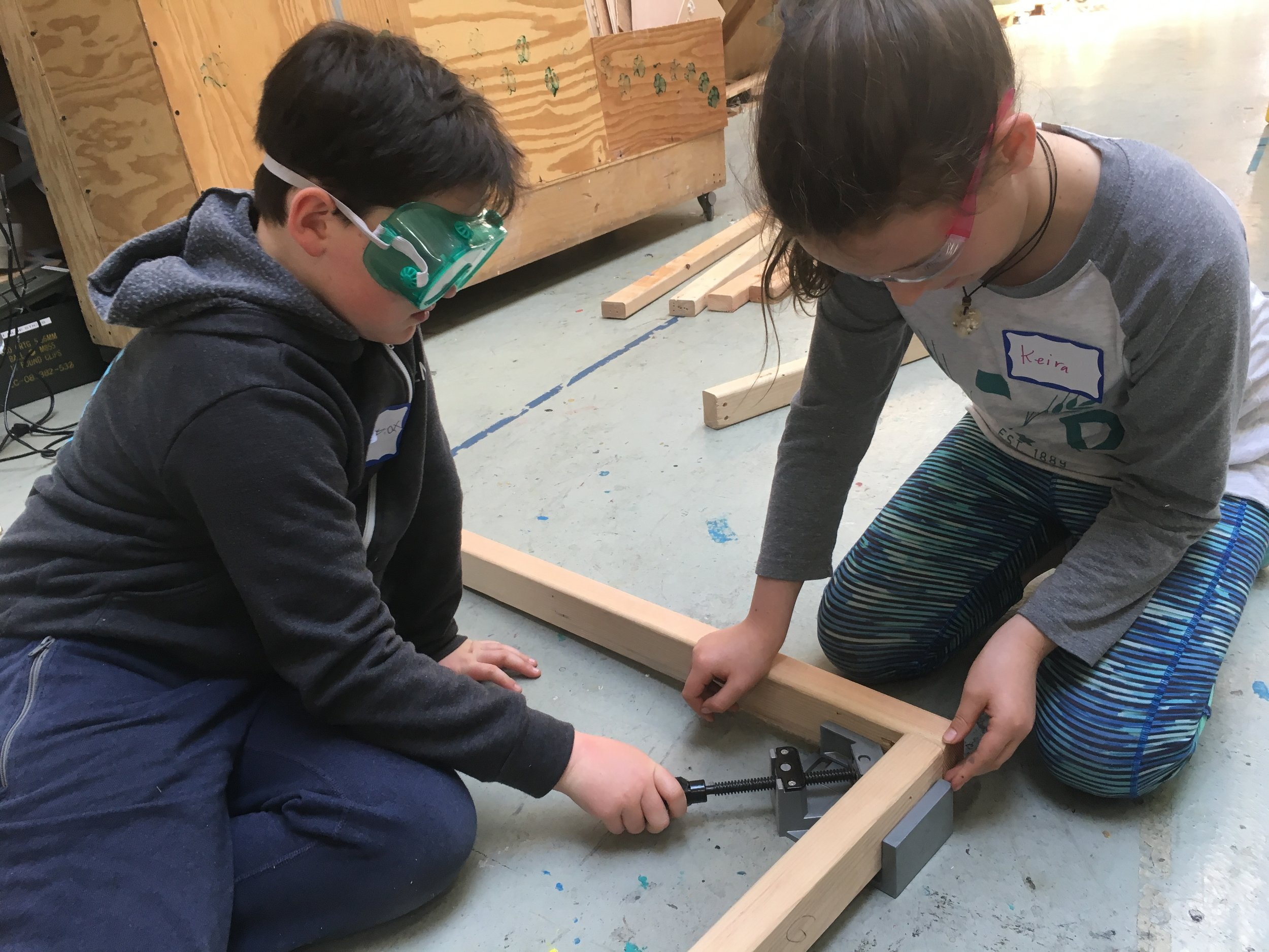 Elliot and Keira square up the corners to build their frame.