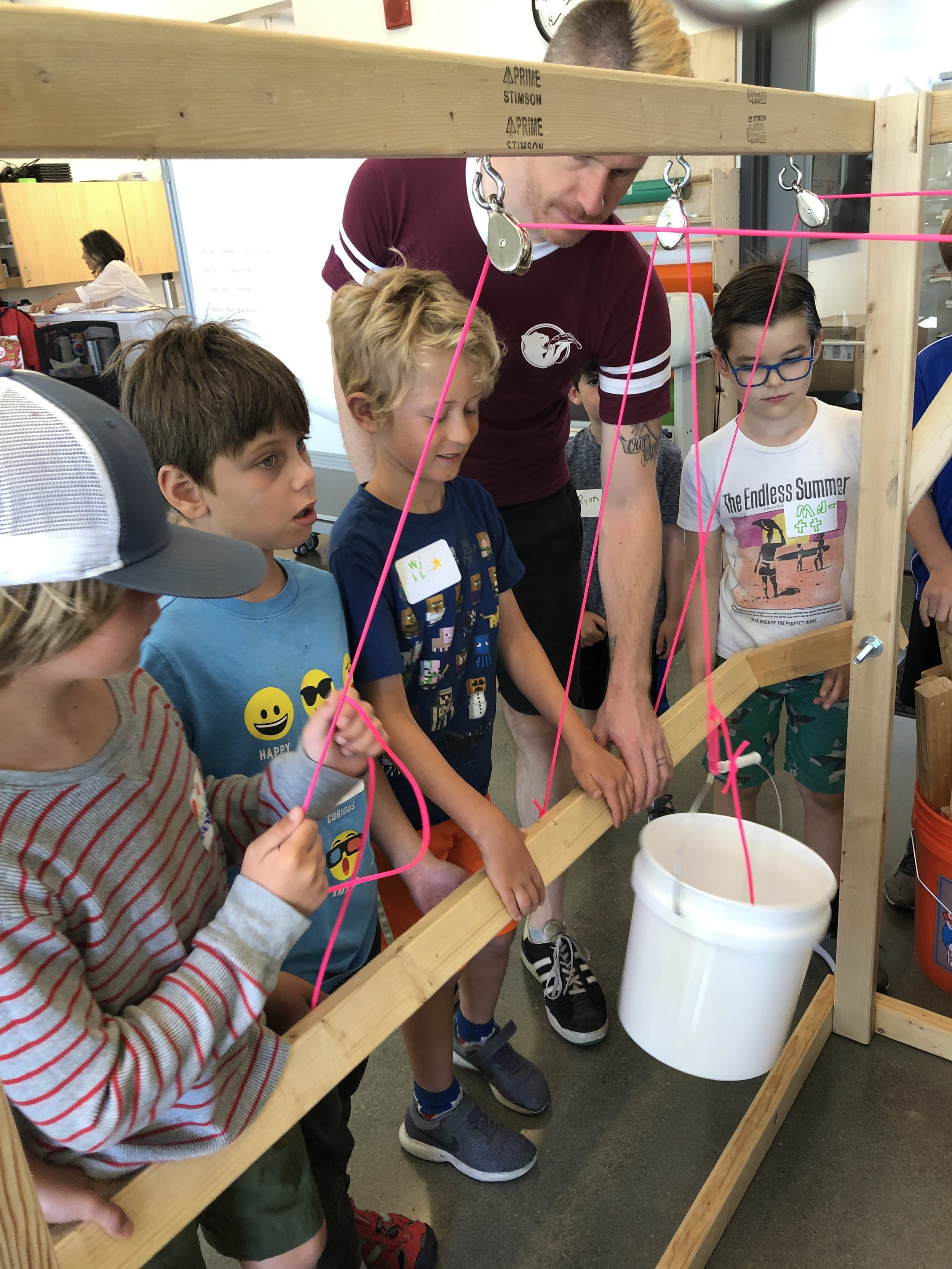 Our collaborators built a pulley station to help demonstrate how pulleys can be used to extend our reach and to lift heavy weights.