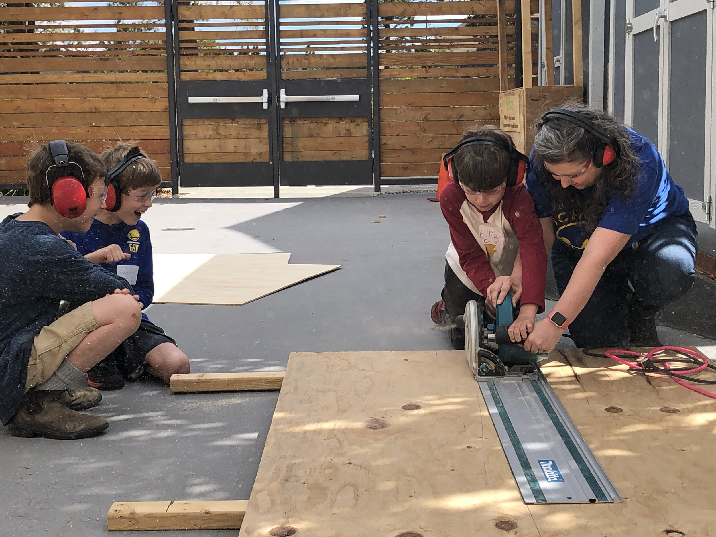 Another day, another tool! Today, a few tinkerers practiced with a circular saw which is great for helping us make straight cuts along plywood.