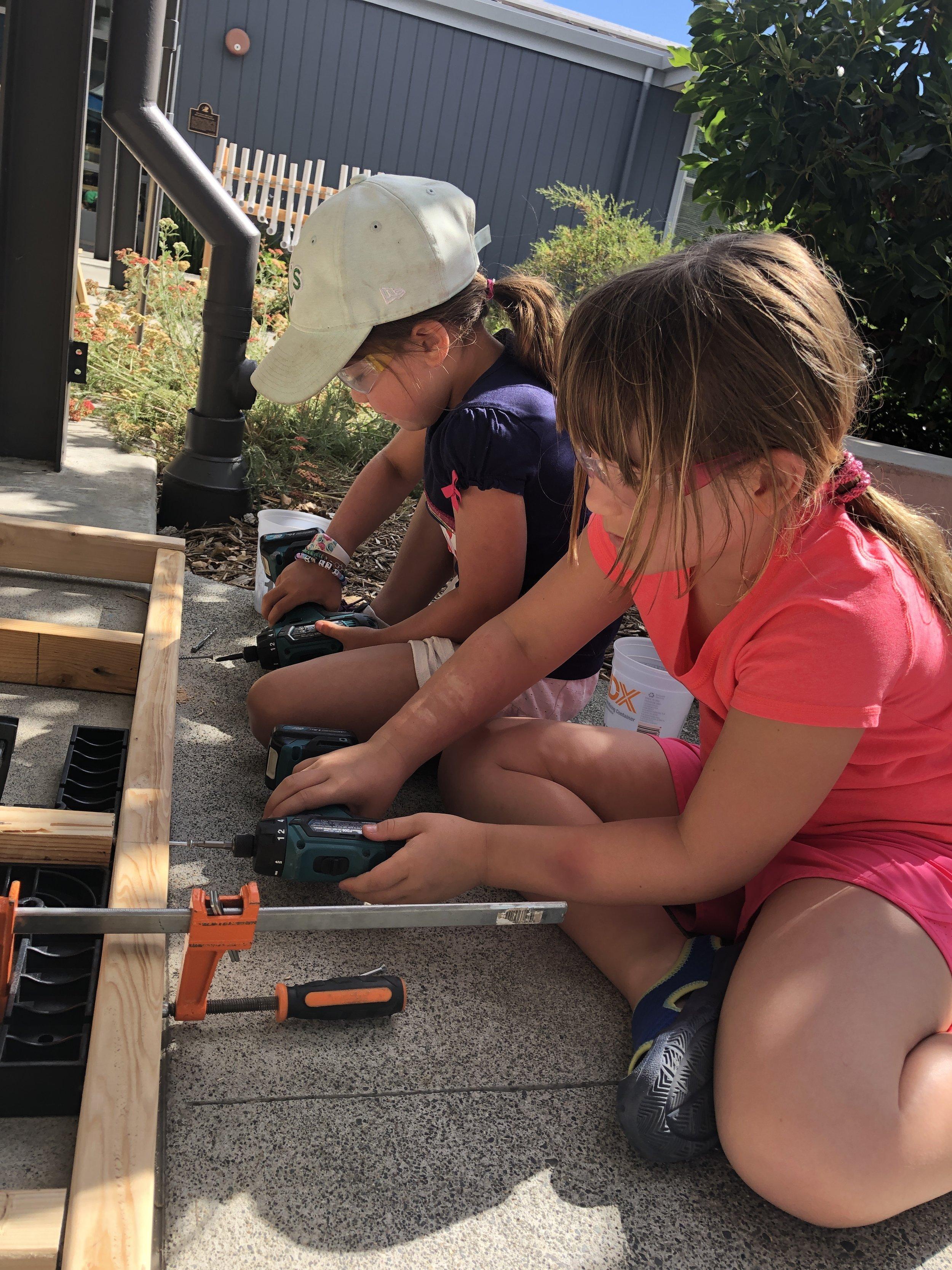 two kids drilling.JPG
