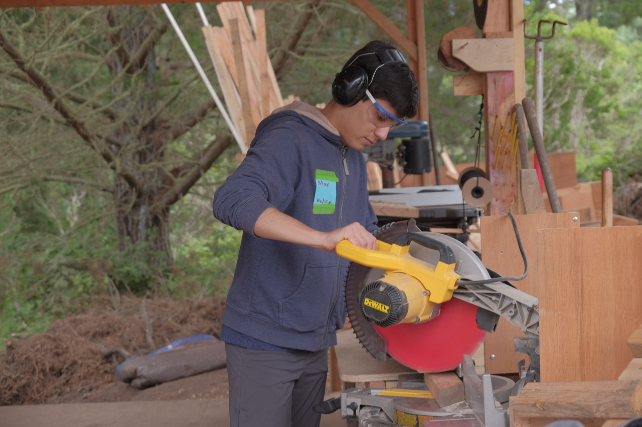 Max makes an angled cut on the chop saw.