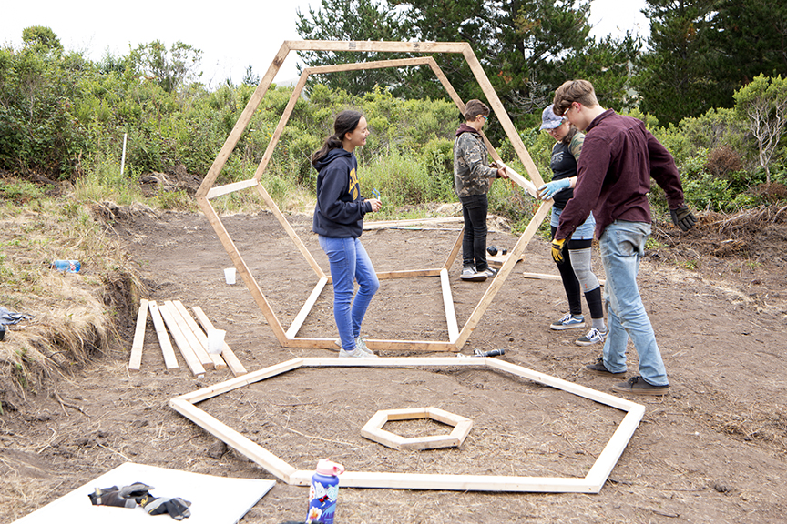 Team Mars Shelter works at securing the joints on The Underrated Rad Turtle Loco Extraterrestrial (TURTLE,) their hexagonal Mars home.