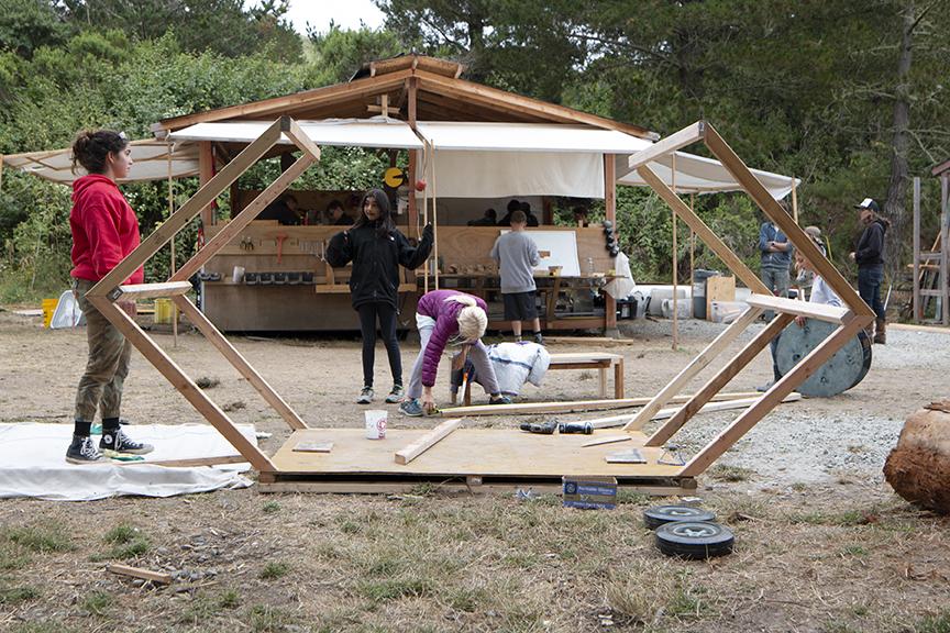Collaborator, Anna, helps the junior gondola team build their mobile Mars housing frame.