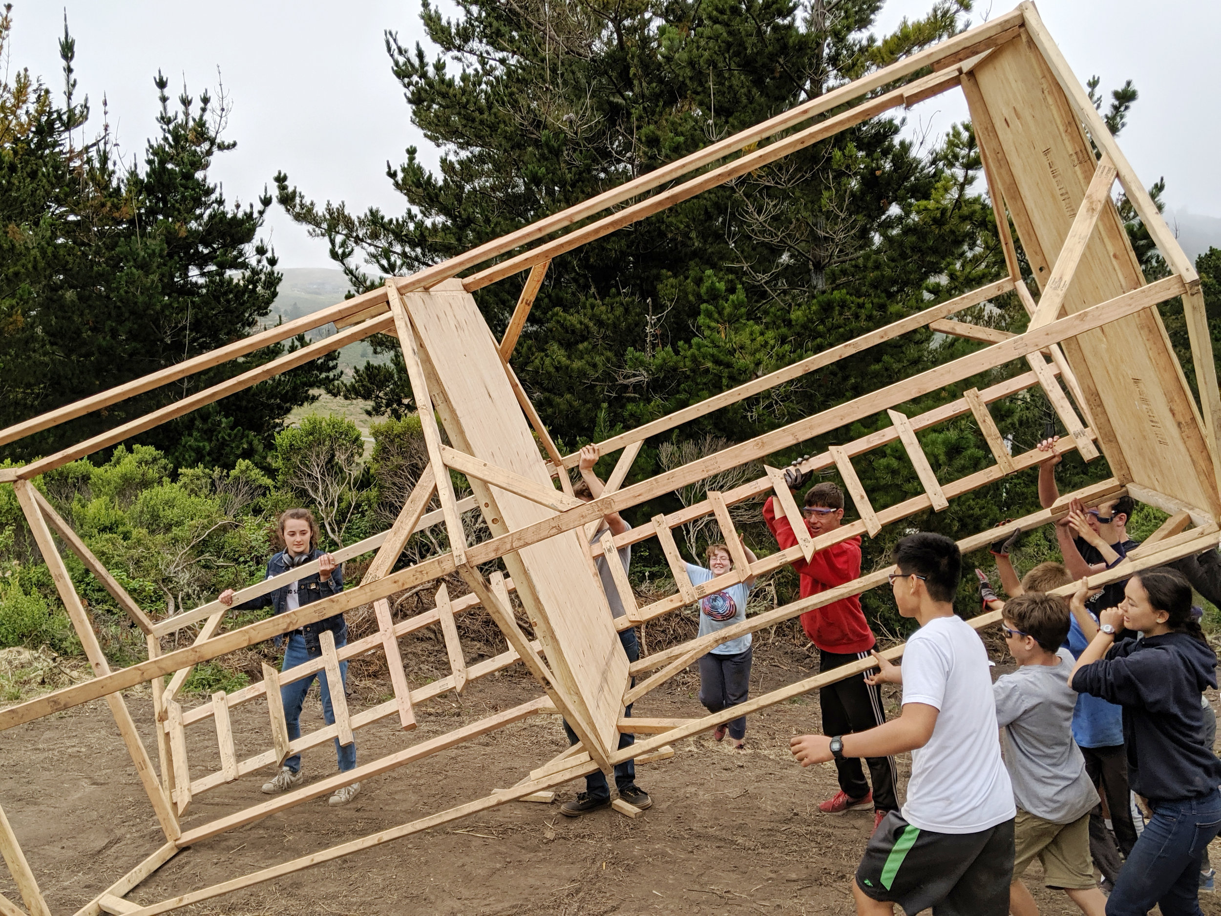 Senior Tinkerers and collaborators worked together to raise a two-story shelter frame.