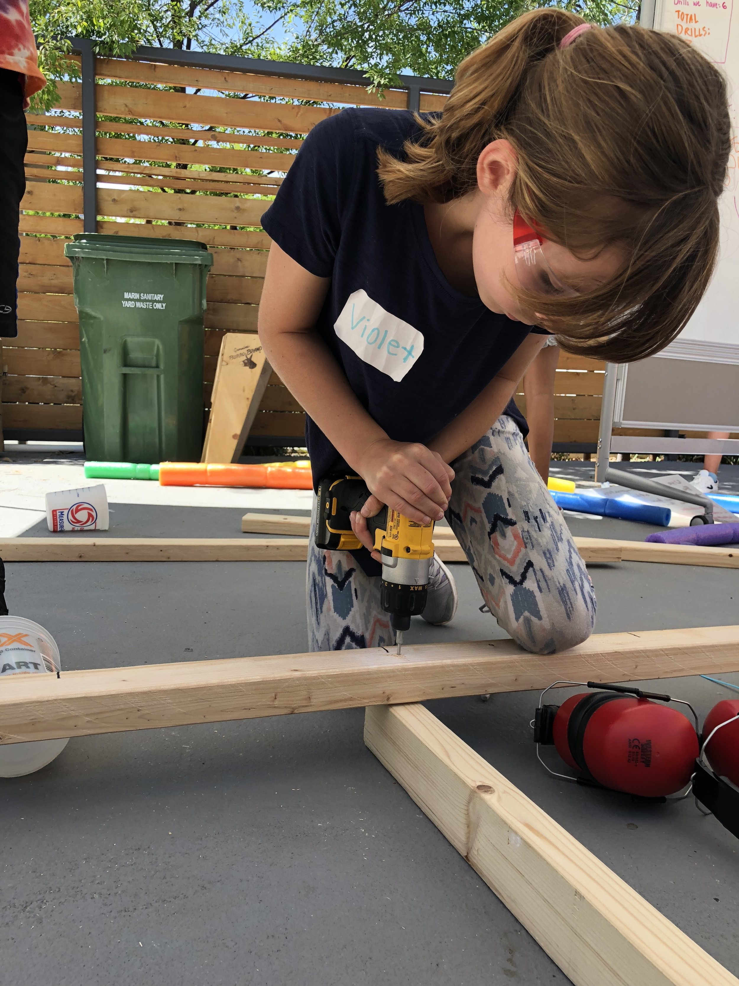 """During tool training, tinkerers learned to hold wood secure with a knee, foot, friend's hand, or clamp (which we refer to as a """"third hand"""")."""