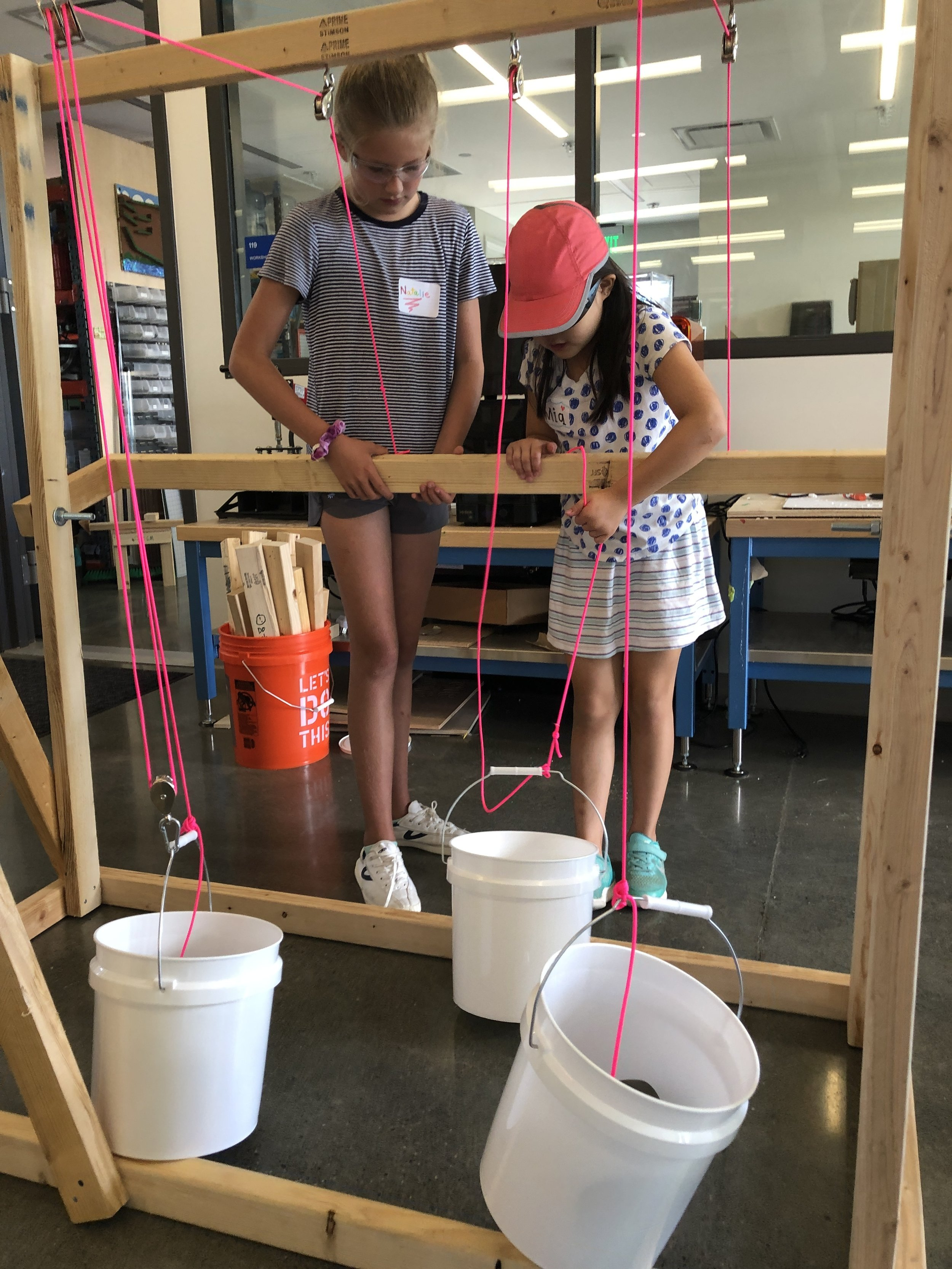 Trying out our pulley station. With one pulley, force can be re-directed but with two pulleys, the force required is only half.