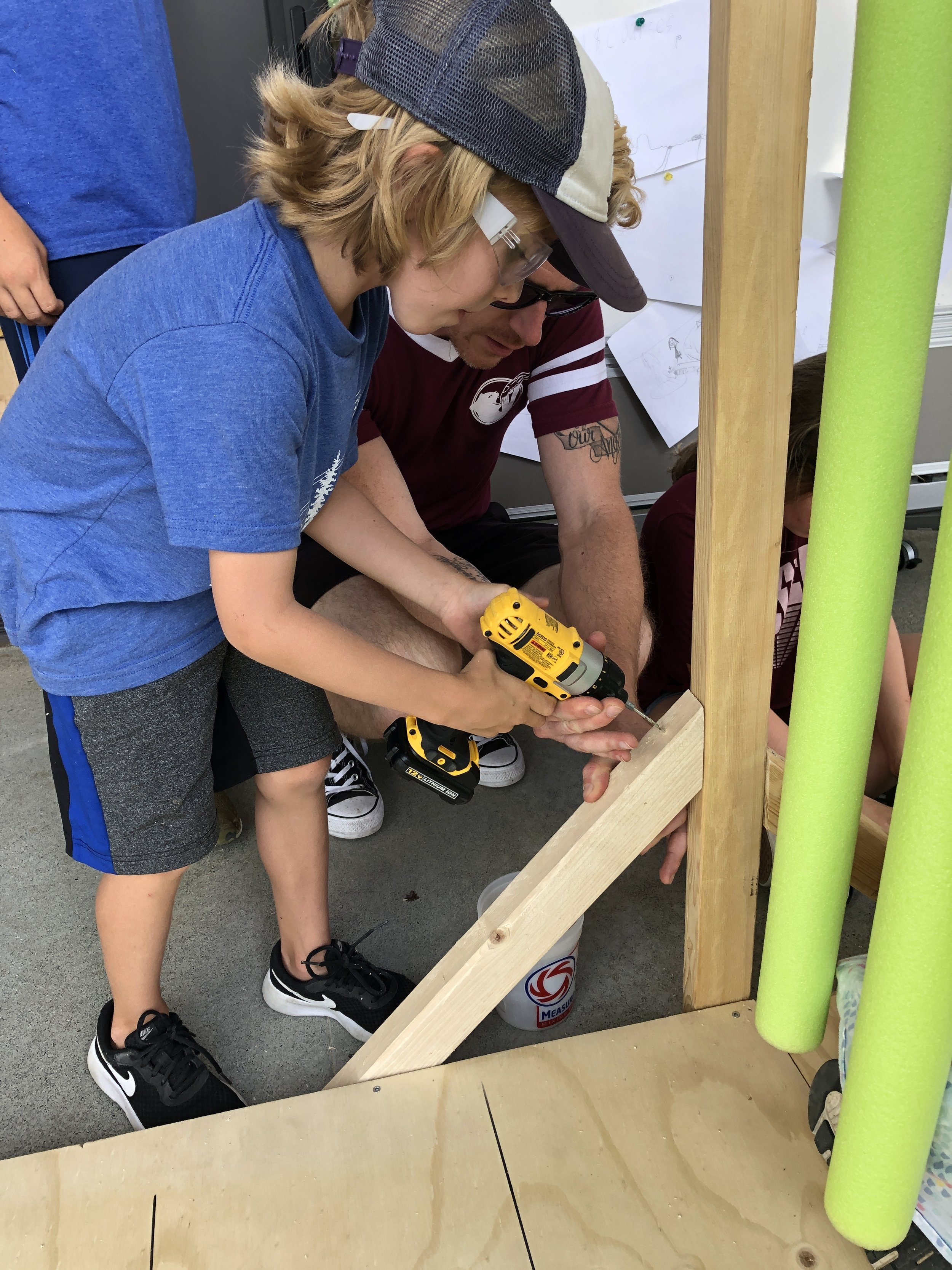 Adding another triangle to secure the frame to the mini golf platform.