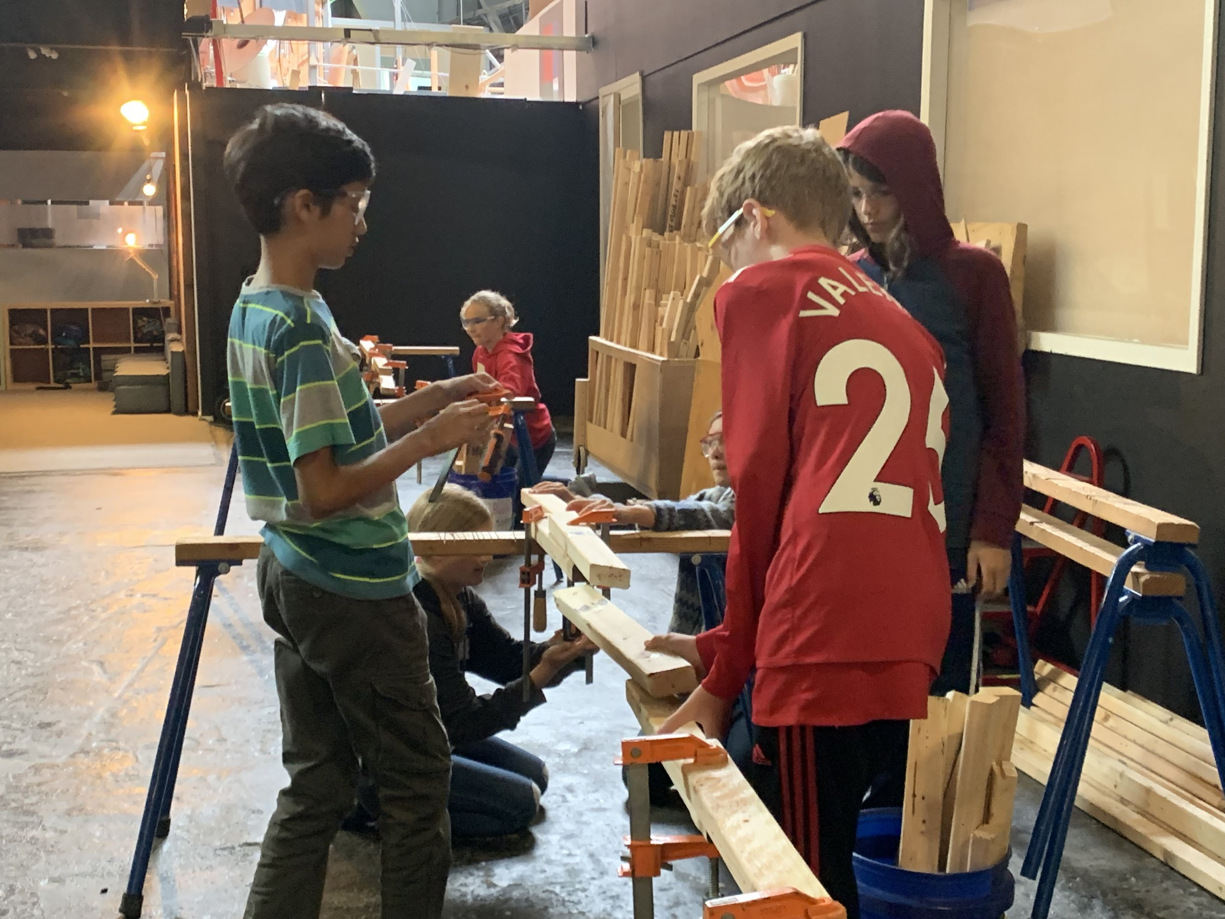 Learning to collaborate and build a bridge out of wood & clamps