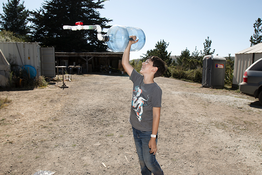 A.J. celebrates his eleventh and final attempt at creating a water storage and spigot release for his team's RV sink.