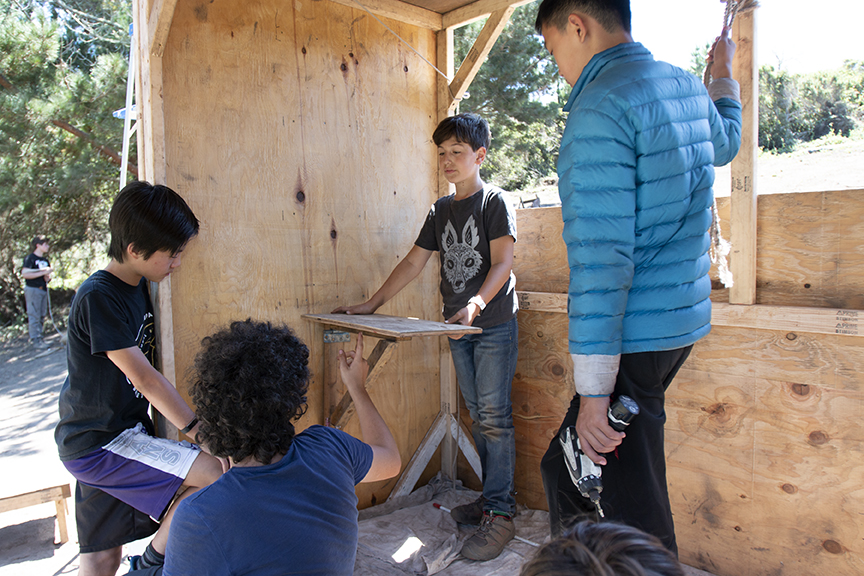 Senior Tinkerers, Jasper, Akin, A.J. and Joey discuss attaching their collapsible table.