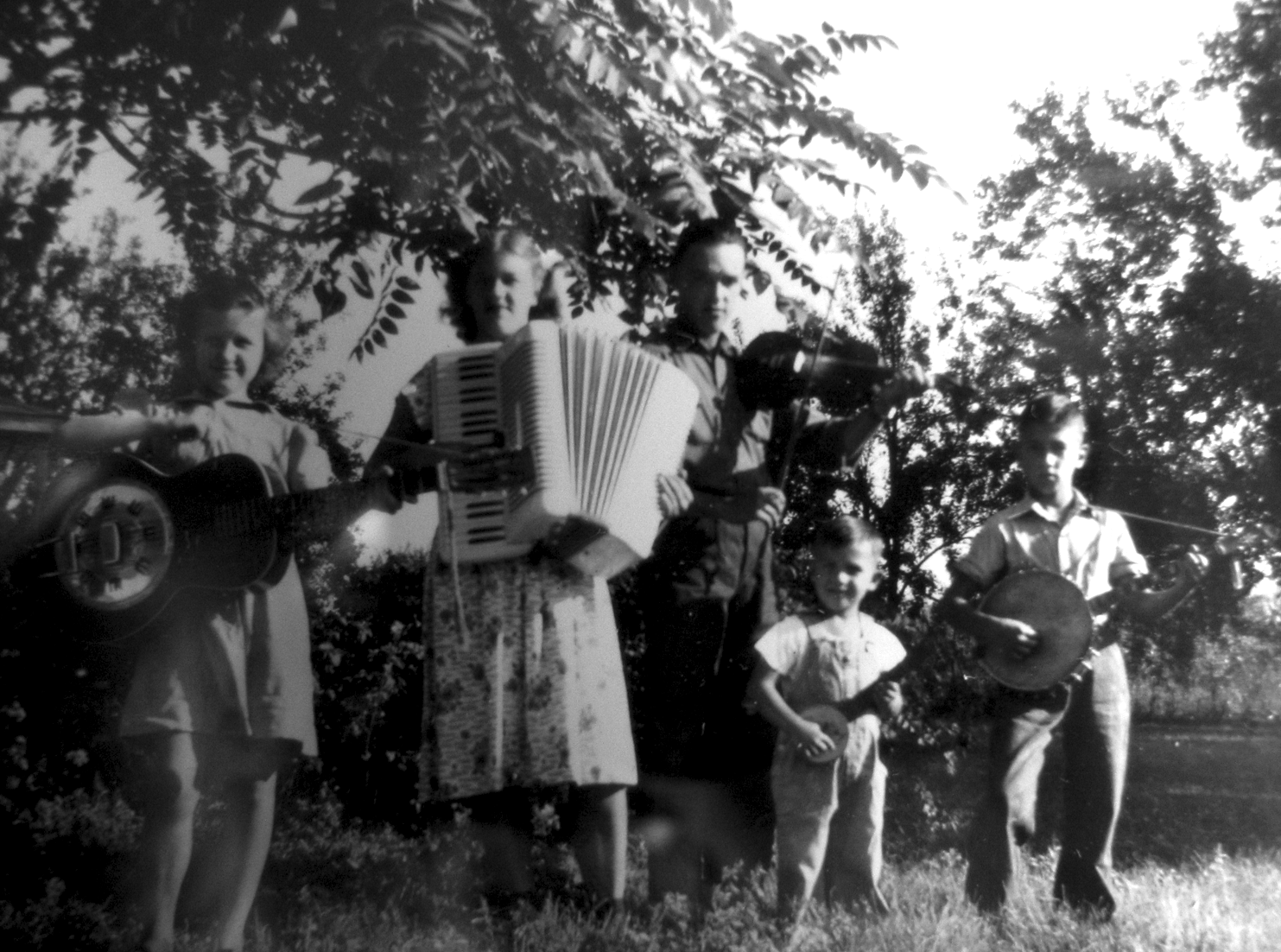Bill (youngest) playing music with his siblings