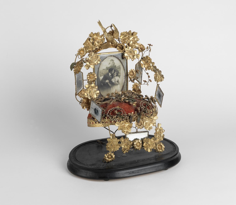 Victorian gilt wedding altar inset with a photograph of an amorous couple. Circa 1900