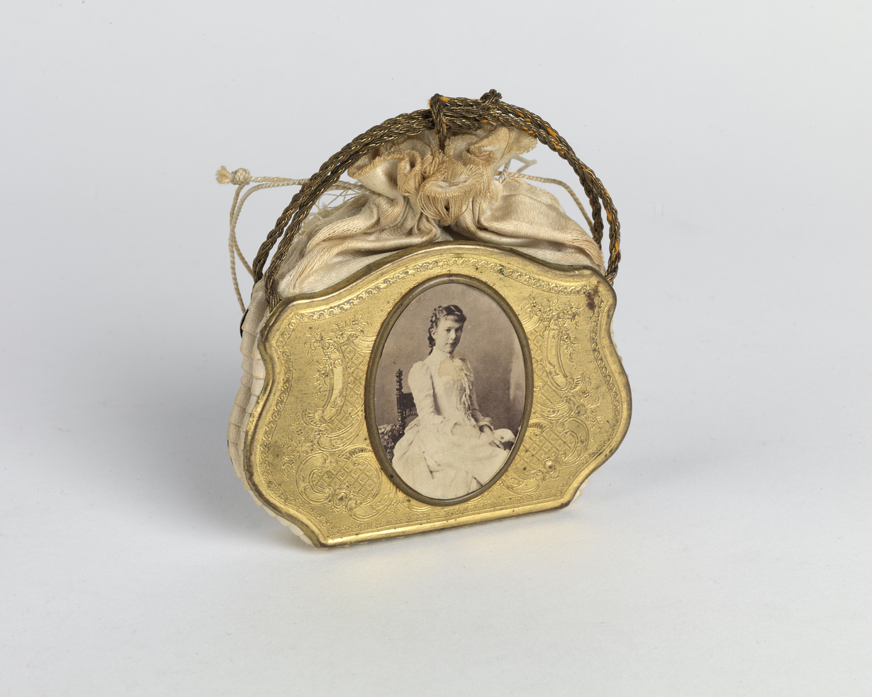 Venetian-style child's purse with an albumen portrait. Circa 1861