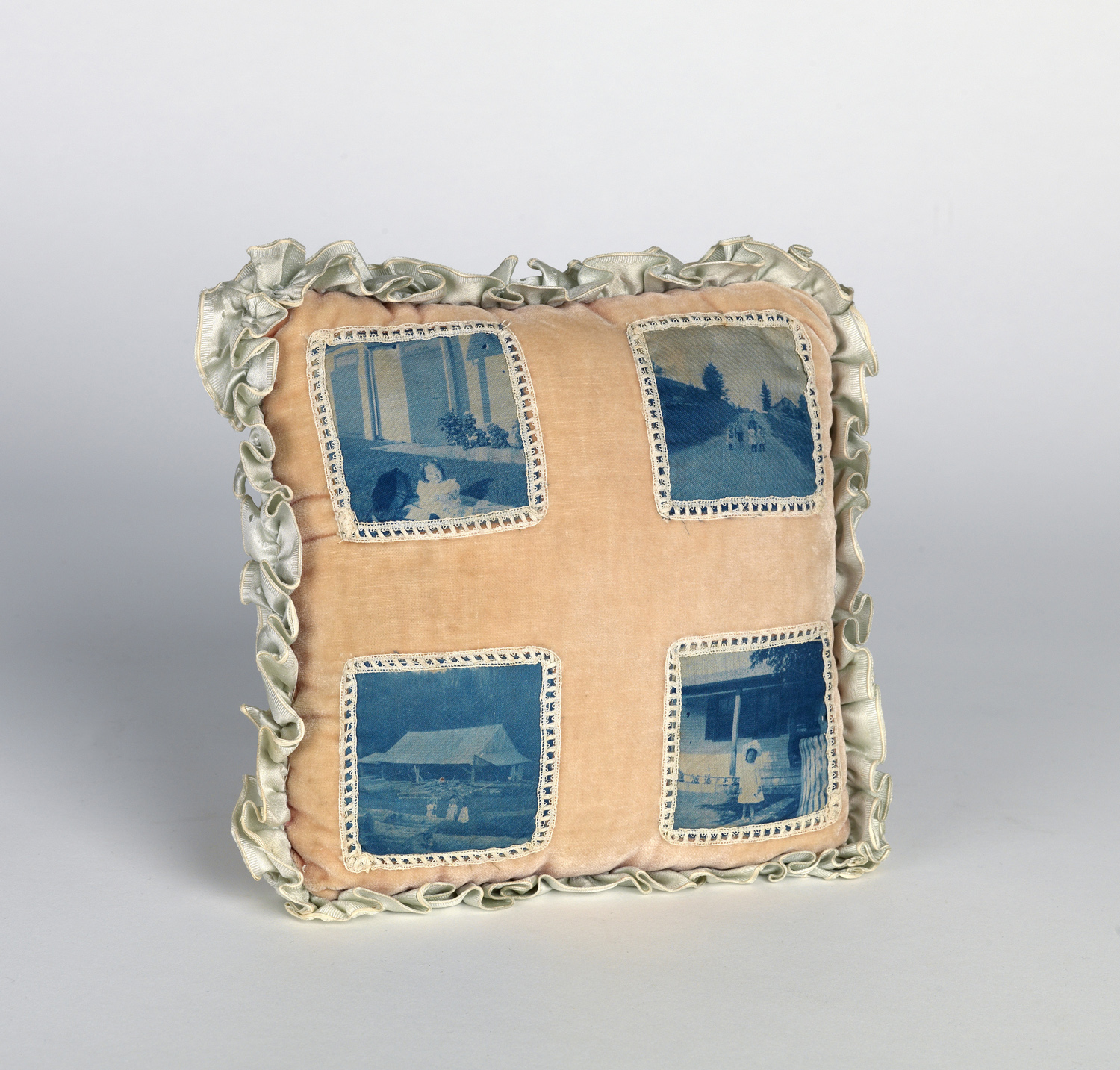Child's pillow case highlighted with cyanotypes. Circa 1895