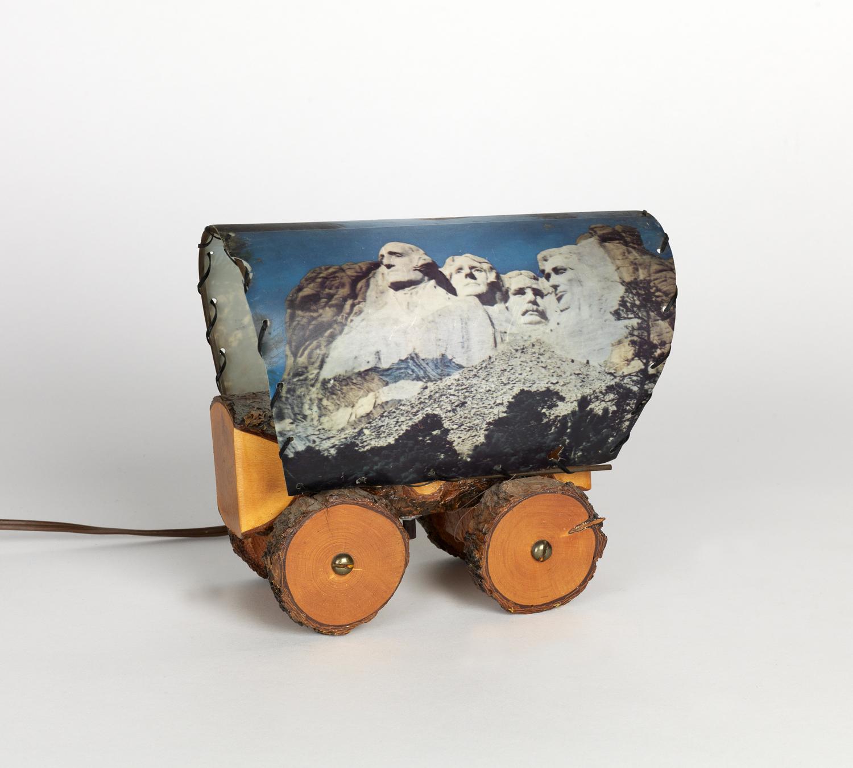 Television wagon wheel lamp, with image of Mt. Rushmore. Circa 1958