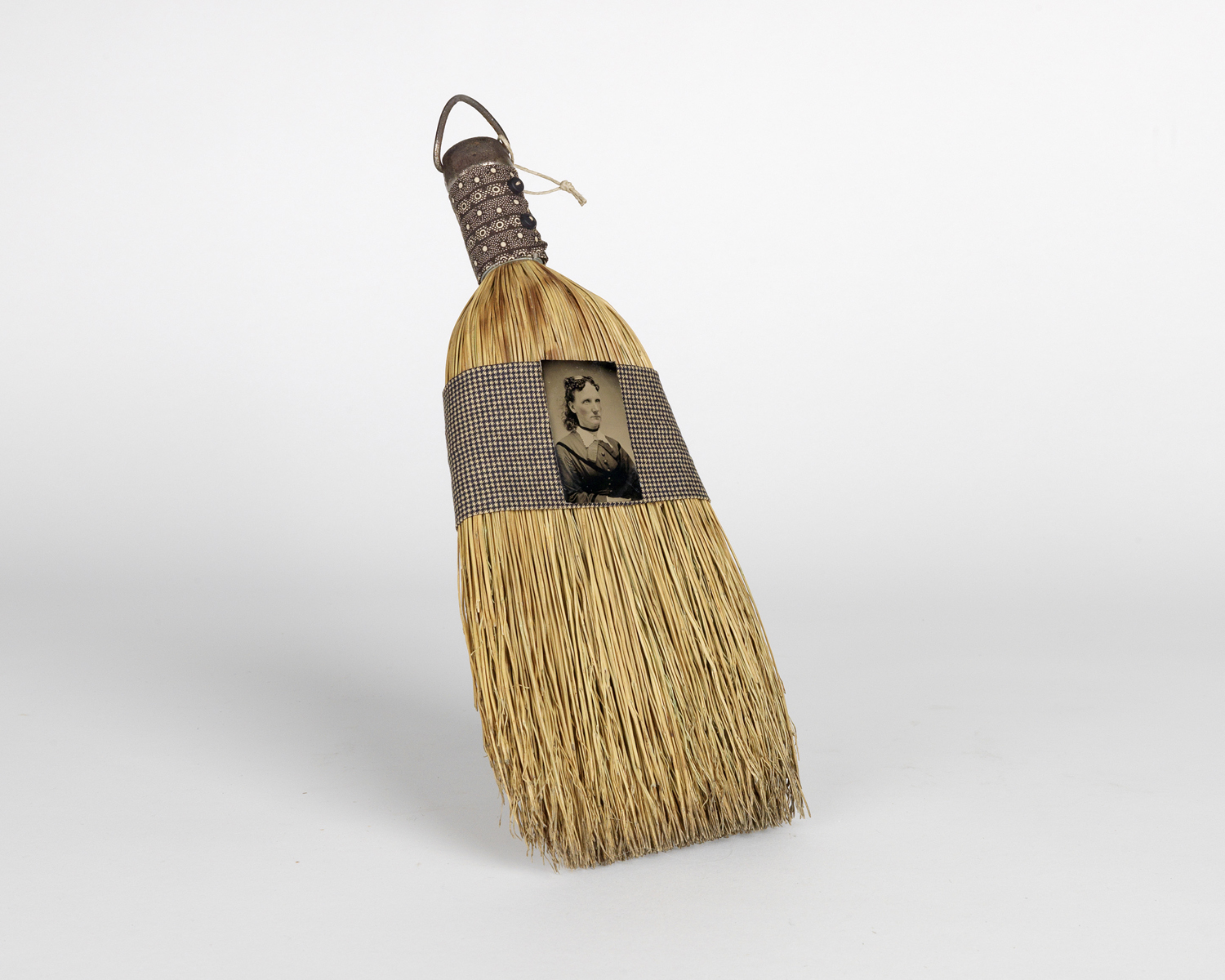 Reworked period broom adorned with a vintage tintype and fabric by artist Elaine Hunstman. 1880s-1990s