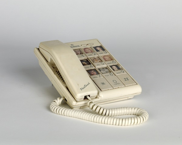 Touch phone with images of friends and family members. Circa 1970