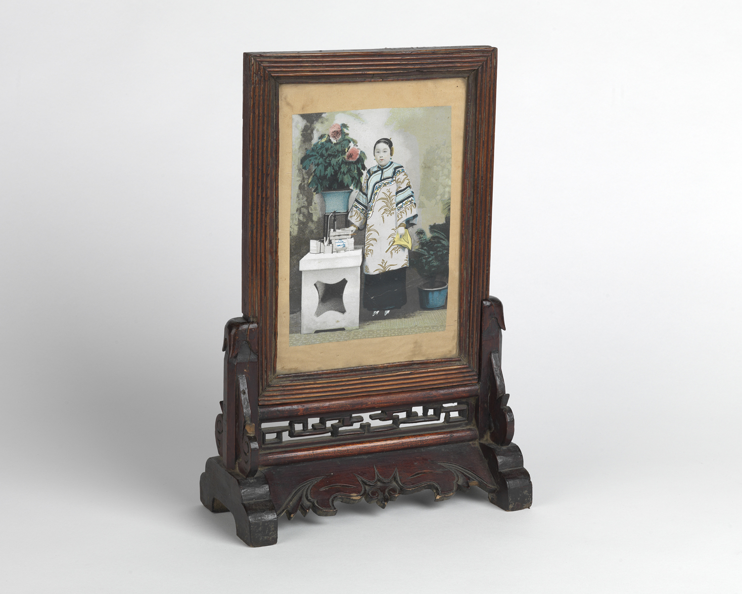 Period Chinese altar piece with hand-tinted portrait of a woman with bound feet.  1890s