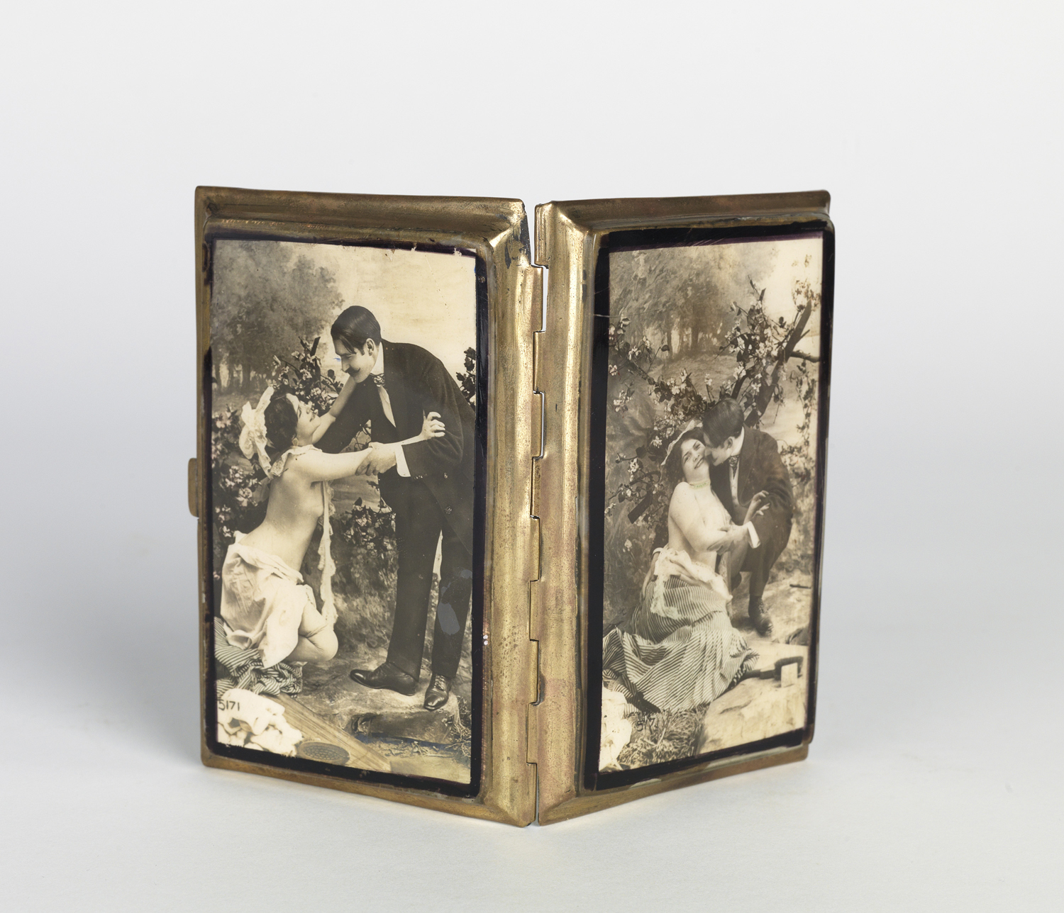 French cigarette case with images on celluloid of an amorous couple.  1900s