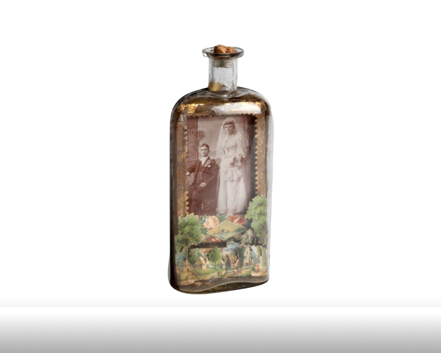 Whiskey bottle with portrait of newlyweds set against a die cut pastoral background. 1880s
