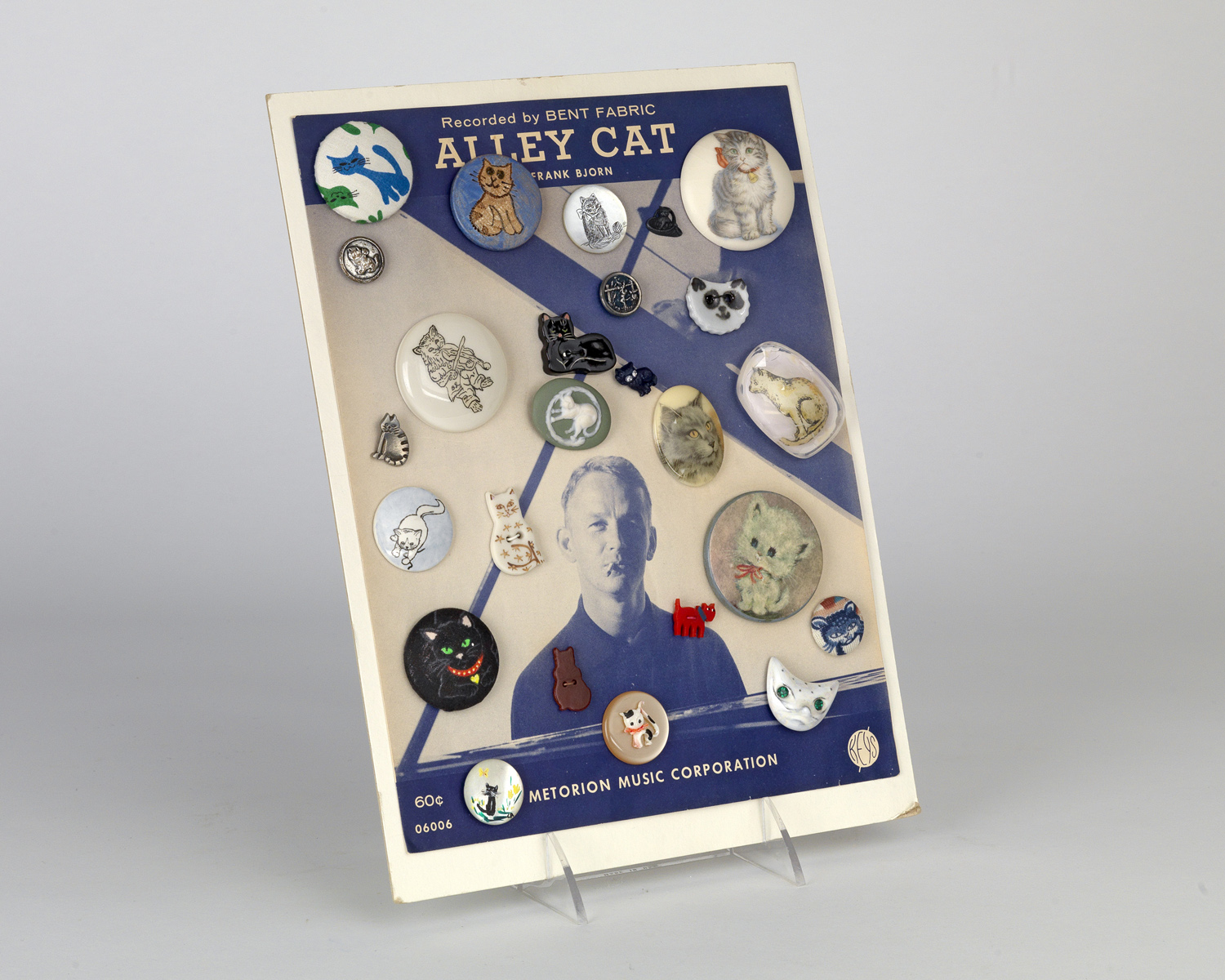 Buttons highlighted with images of cats set against the score of Alley Cat. Circa 1961