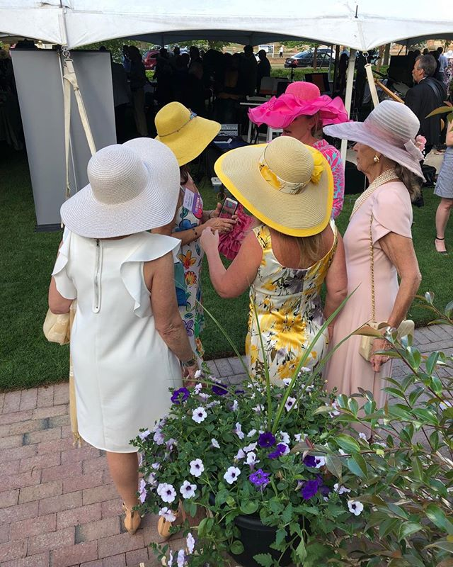 A garden party in Wlson. Love the hats!