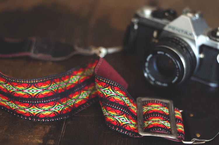 Not only did I score an old camera to screw around with, I also found this woven strap which has already replaced my old one!