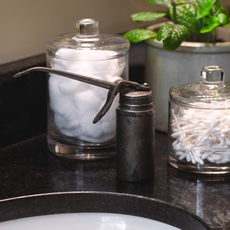 Not your typical use for this aging oil can, but it's the perfect soap dispenser in my rustic bathroom. It's inspired me to repurpose other rusty tools for the bath.