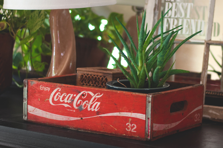 I love old Americana - This beat-up Coca-Cola crate is perfect for holding 'stuff and things' atop furniture and could be a great serving tray for patio drinks.