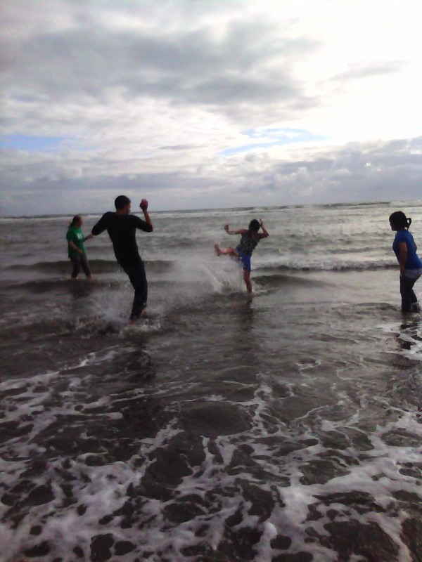 "Teens ""kickin' it"" at the beach"