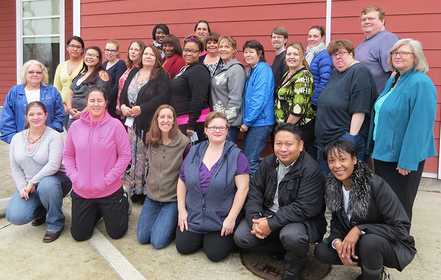 Healthy Living Collaborative's first group of graduating Community Health Workers. Matti is the one in the red sweater.