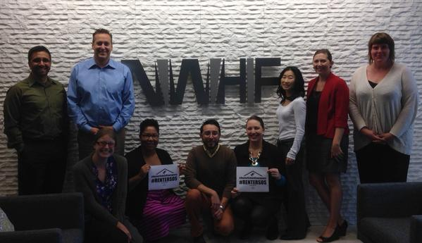 NWHF staff pose with the Renter State of Emergency placard.