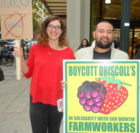 "A man and woman holding picket signs that read, ""Boycott Driscoll's."""