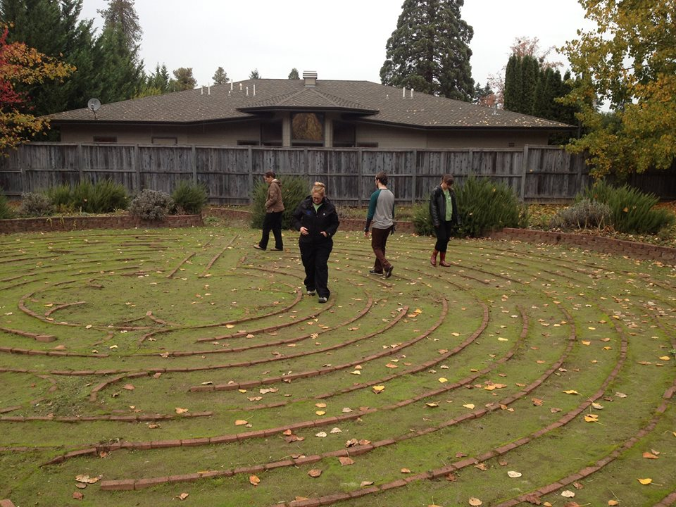 UCC Nursing Group walking the Chartres labyrinth after weeding it.