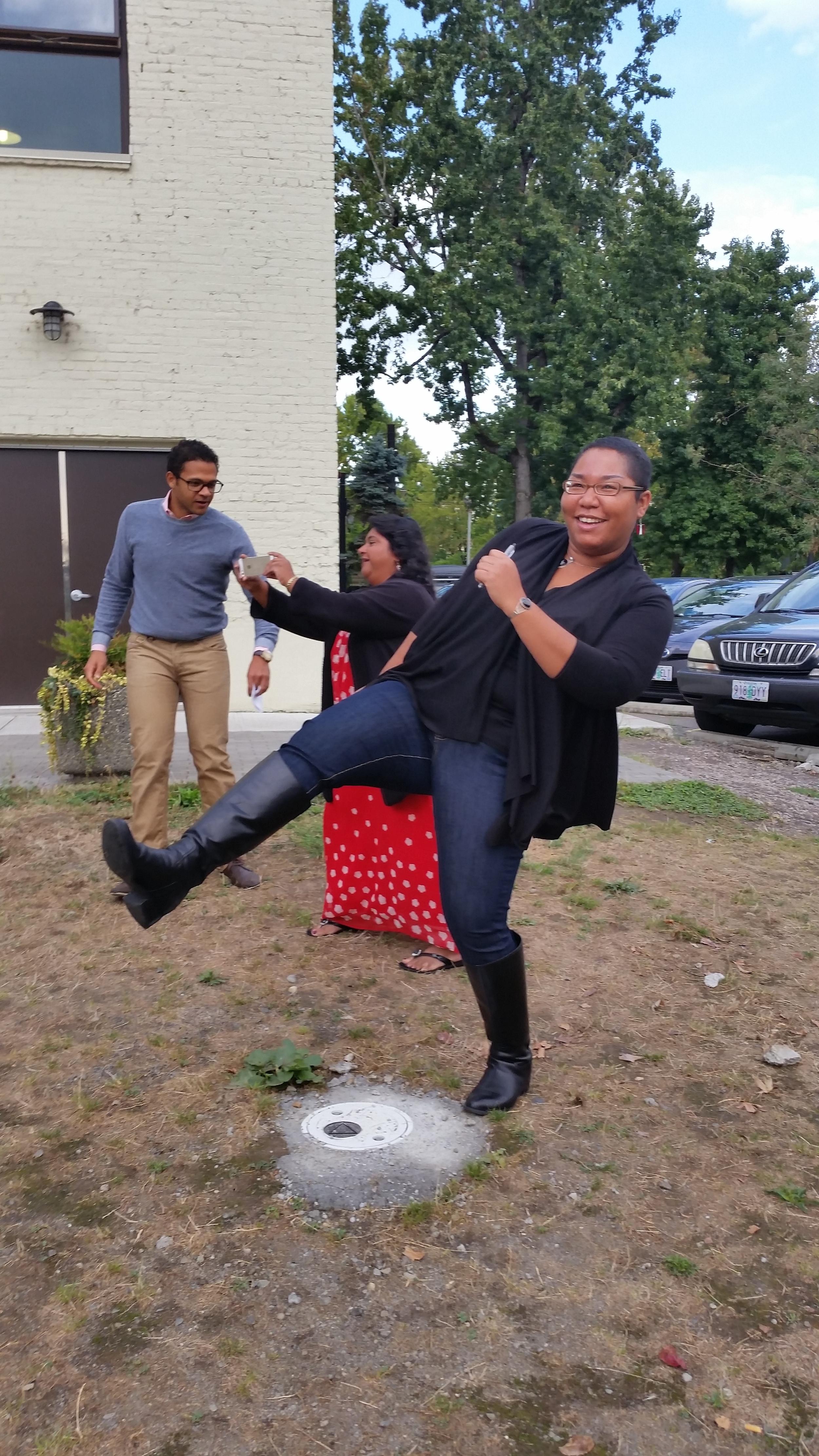 Fannie pretending to kick a kickball.