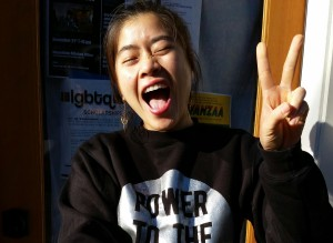 Emily Lai flashing the peace sign. Photo courtesy of Momentum Alliance.