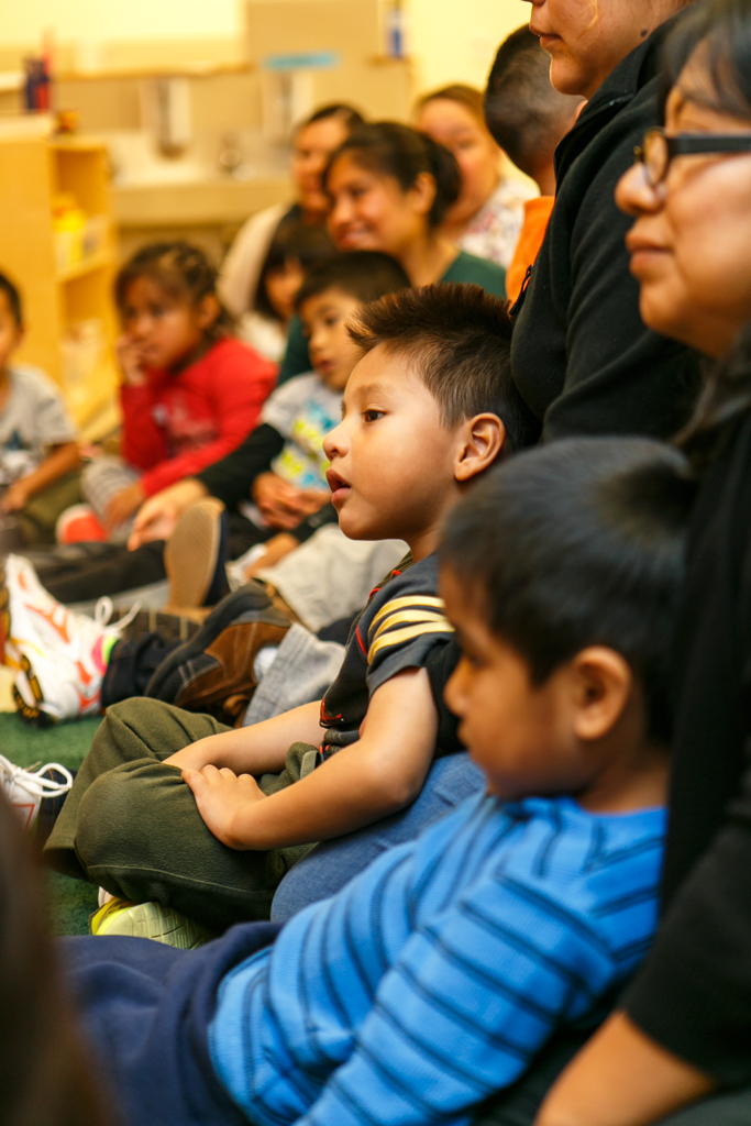 Storytime with kids and parents at Adelante Mujeres.