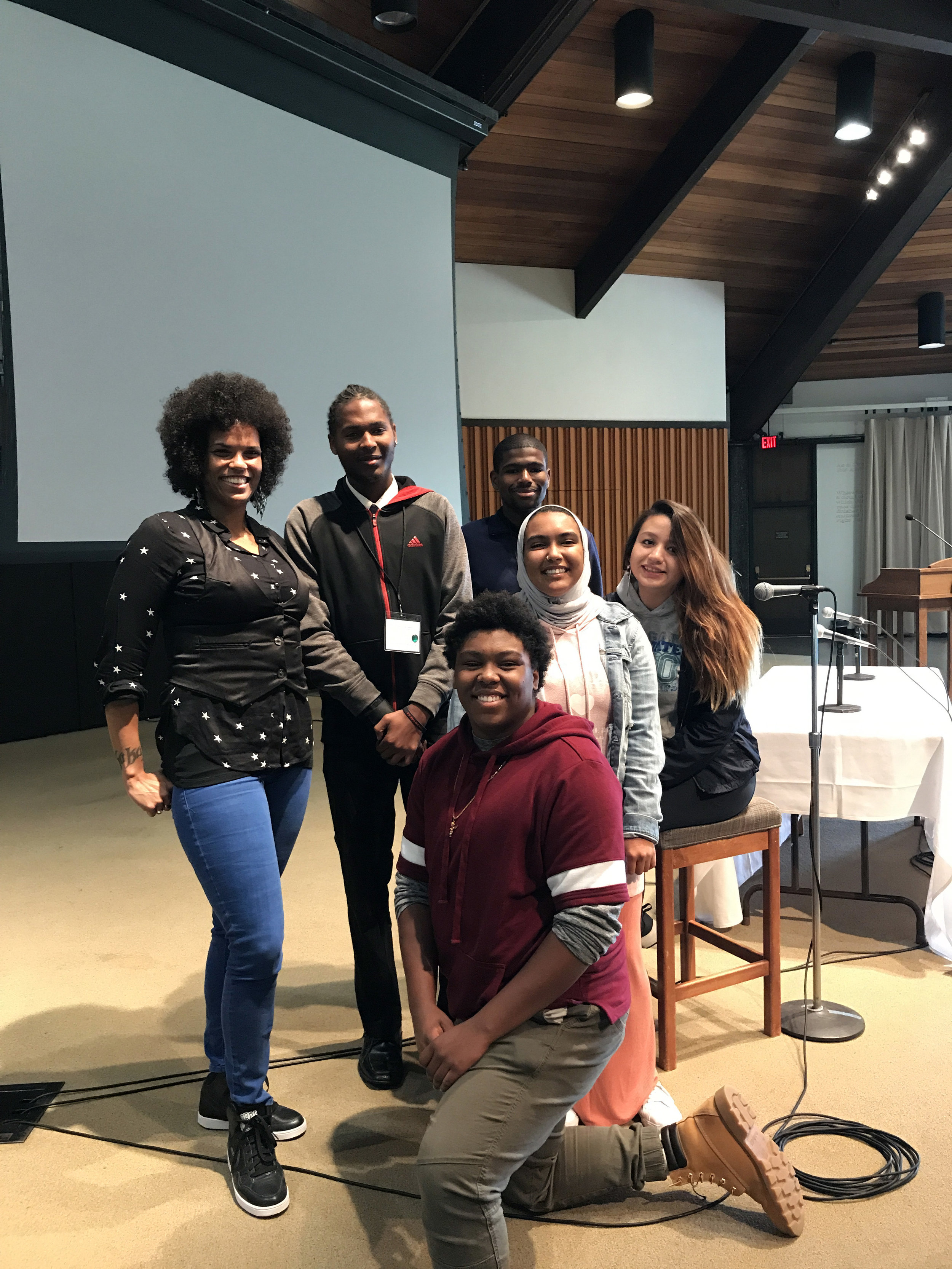 Members of the Youth Equity Collaborative pose with historian and author Walidah Imarisha onstage at our October 2017 Healthy Beginnings+Healthy Communities Gathering.