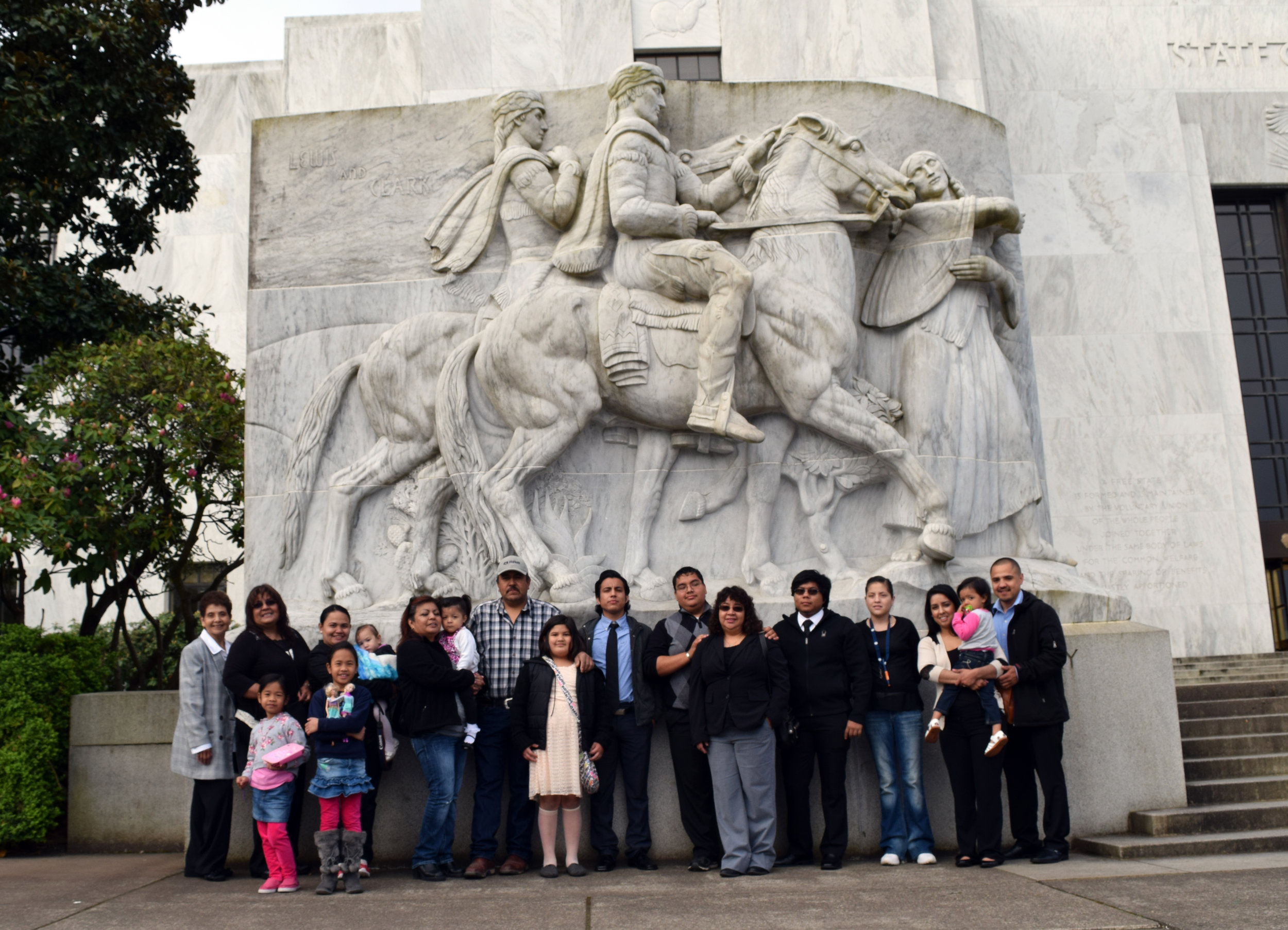 Members of the Eastern Oregon Latino Alliance for Children and Families pose in front of the Oregon State Capitol building.