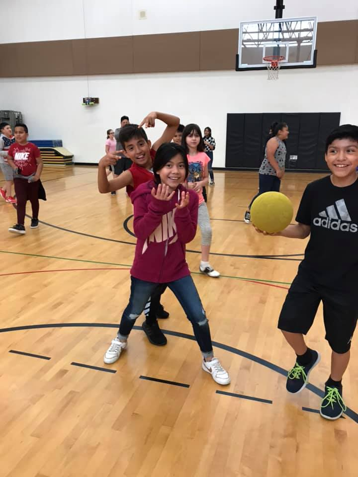 Whitcomb Elementary fifth graders goof around in the school gym. They earned a dodgeball game by working together as a class to improve their attendance! Photo courtesy of Lot Whitcomb Elementary Facebook page.