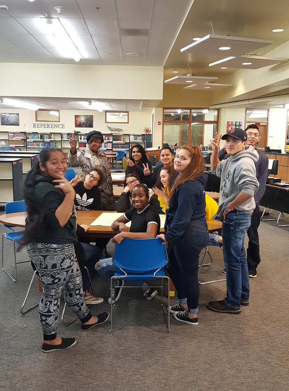 A group of Kelso High School students gather around a table in the library during one of the caucused community conversations.