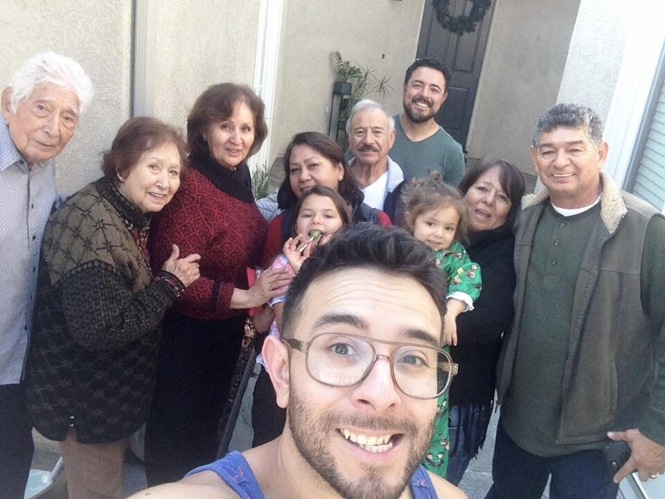 What's Waiting for me in SoCal! [Eddie taking a selfie with ten of his family members.]