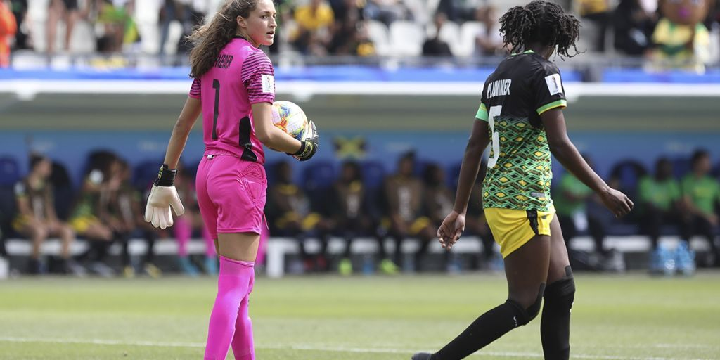 Jamaican goalkeeper Sydney Schneider will return to UNC Wilmington this fall, where much controversy surrounds the height and width of the Seahawks' goal frames.
