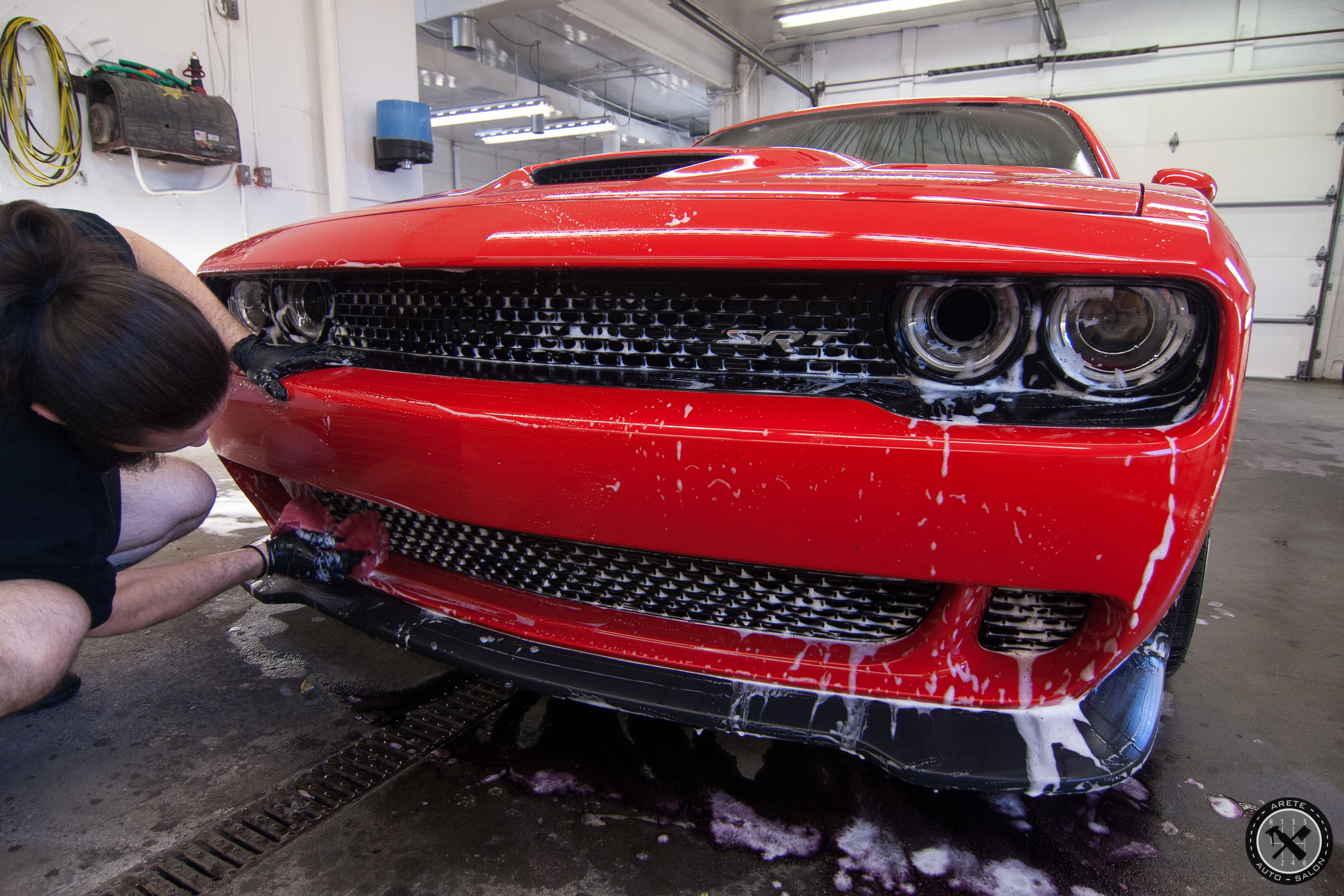 Washing the complex front end of the Hellcat.