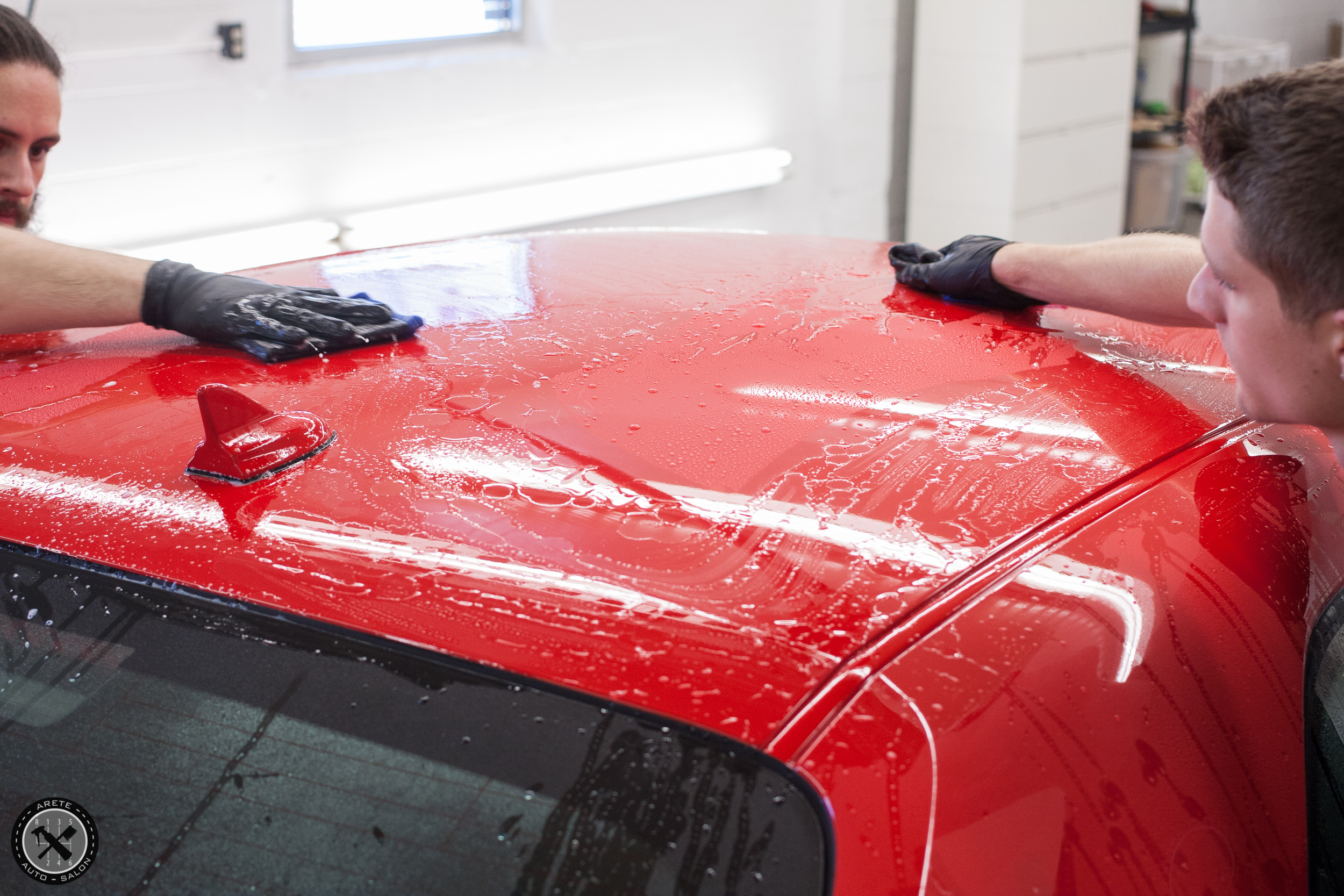 Our detailers in action performing a nano-claytreatment toremove physical contamination from the paint surface prior to paint correction.