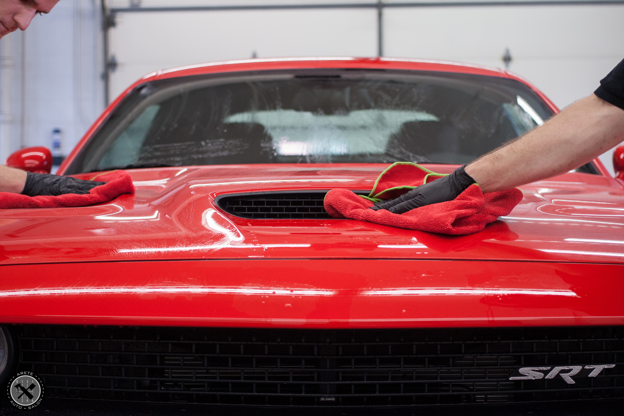 Drying the vehicle with fine microfiber towels post decontamination.