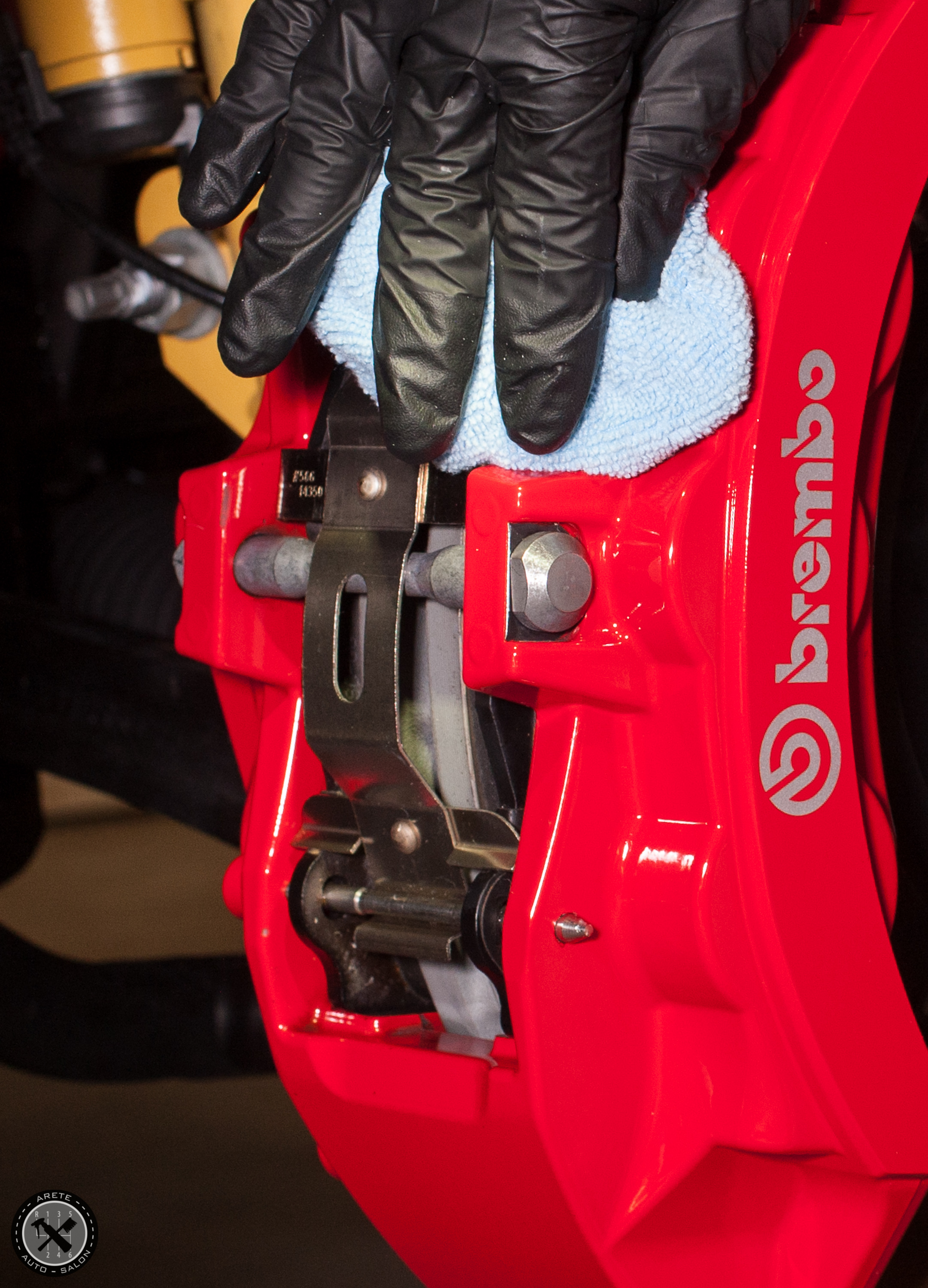 Action shot of the calipers being coated in CQuartz Finest.