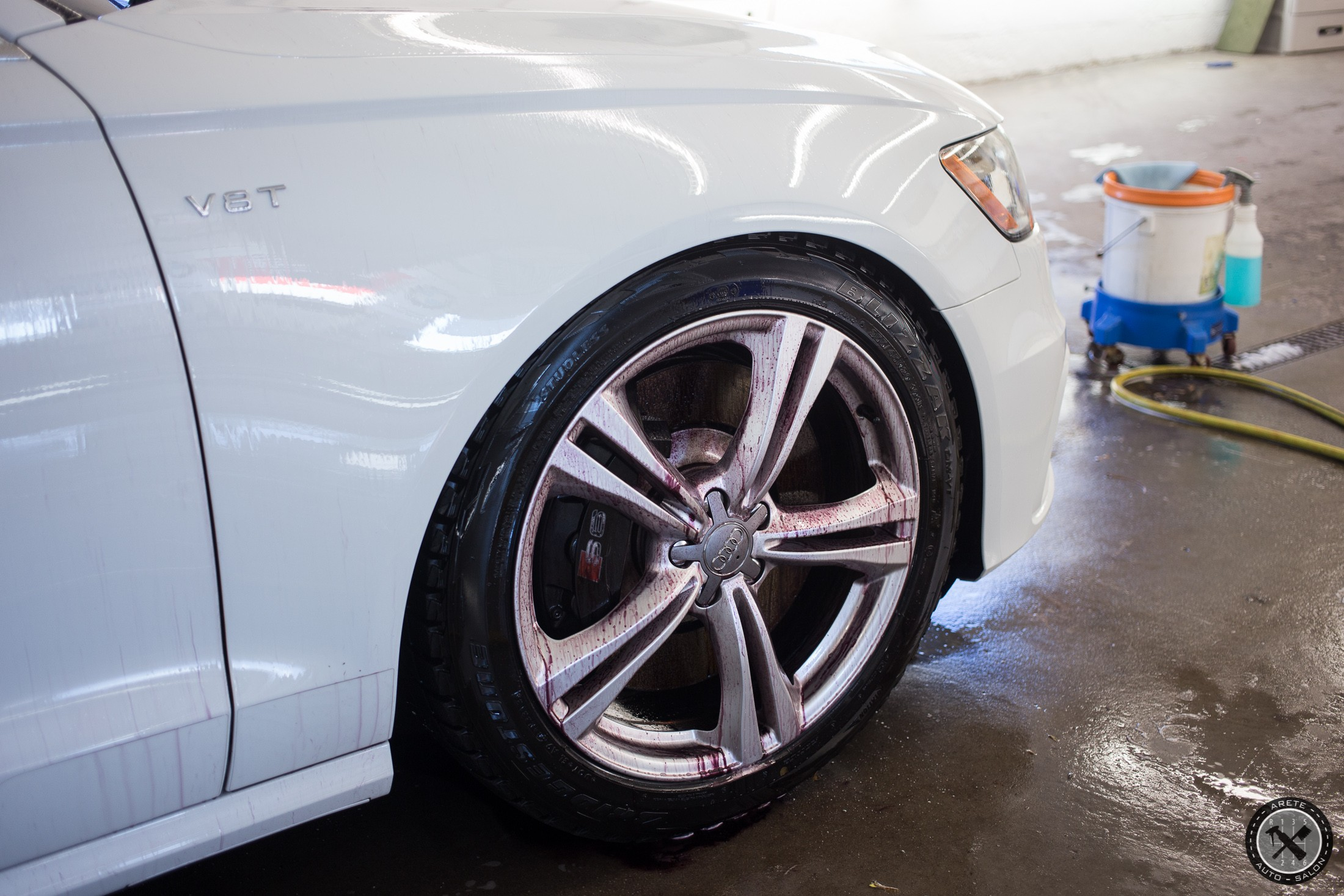 Decontaminating the wheels in preparation for coating.