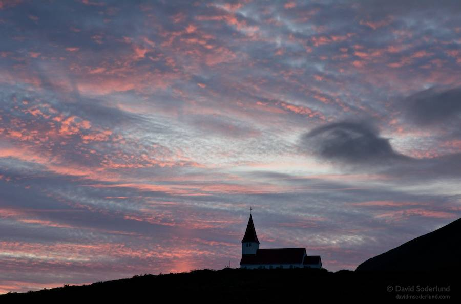 Midnight sky over the church at Vik