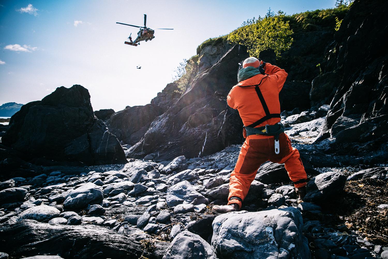 Justin Bastien shooting high angle cliff rescue operations in Kodiak, Alaska.